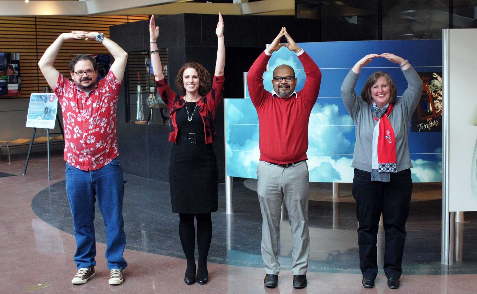 Four employees spelling O-H-I-O