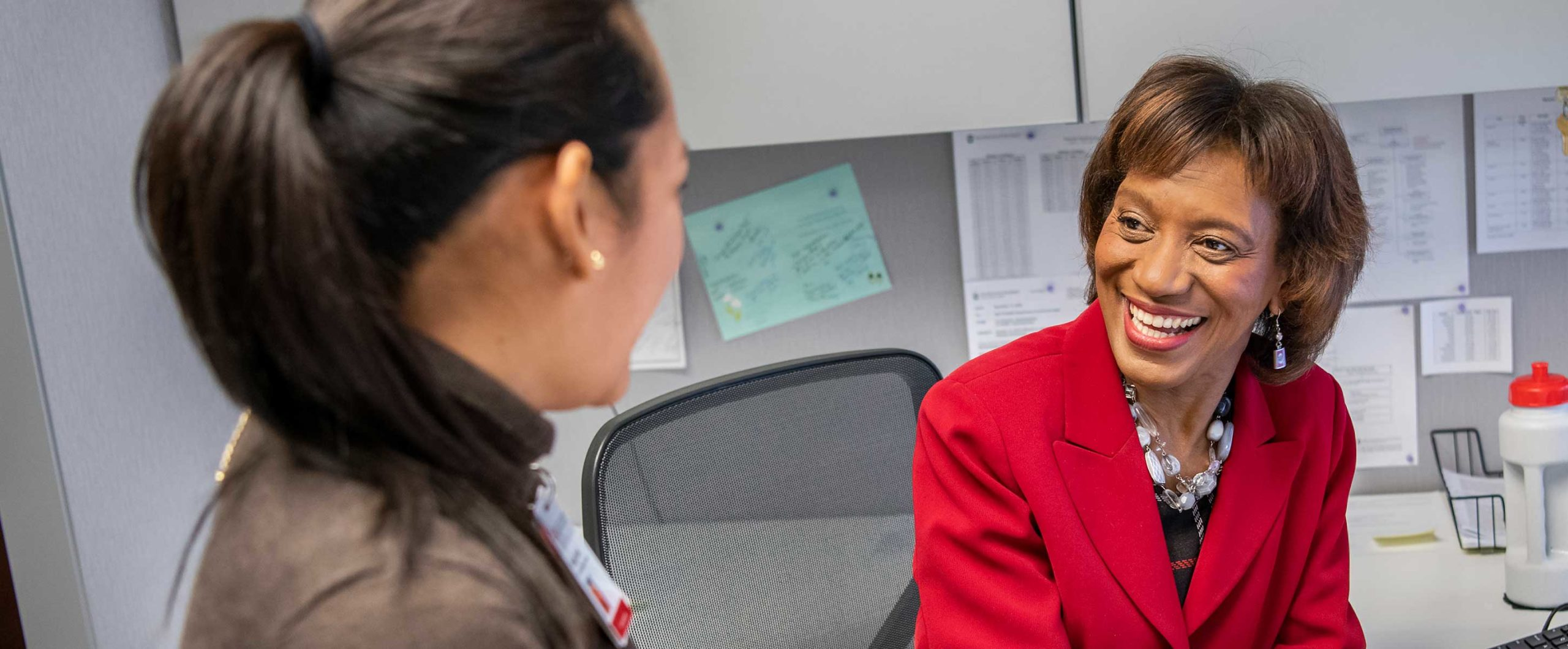 female professor talking to a female student in her office
