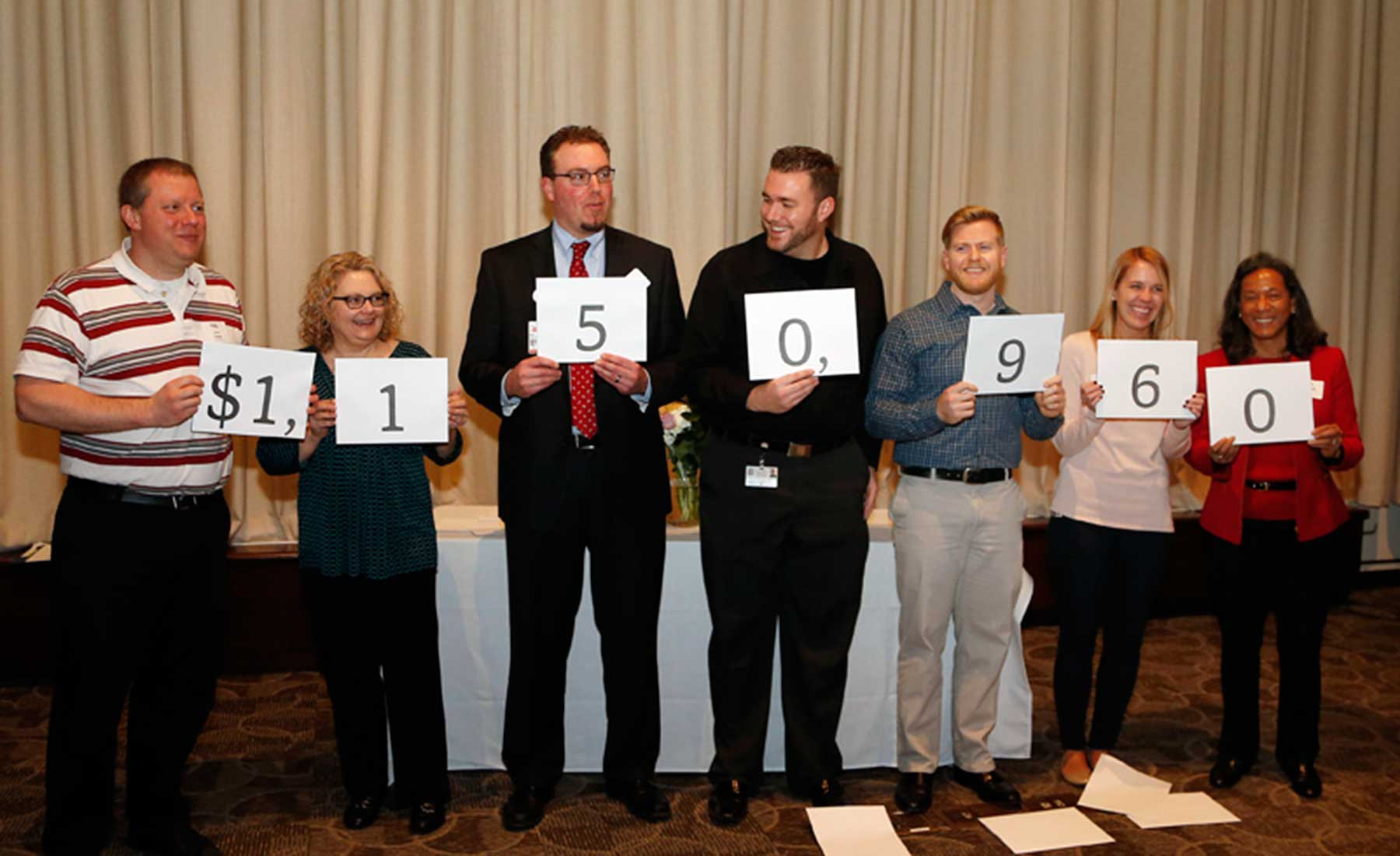 committee members reveal the total for the 2015 Bucks for Charity campaign