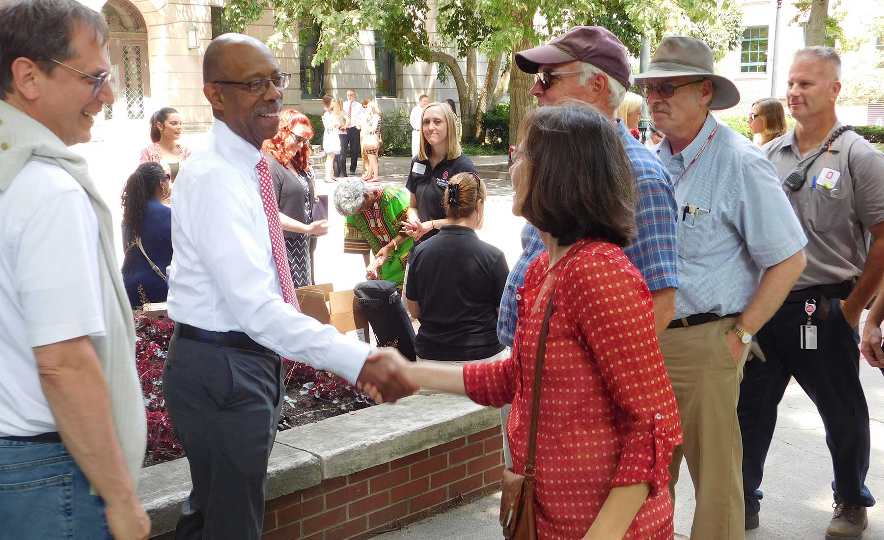 Dr. Drake greets staff members at the ice cream social in 2016
