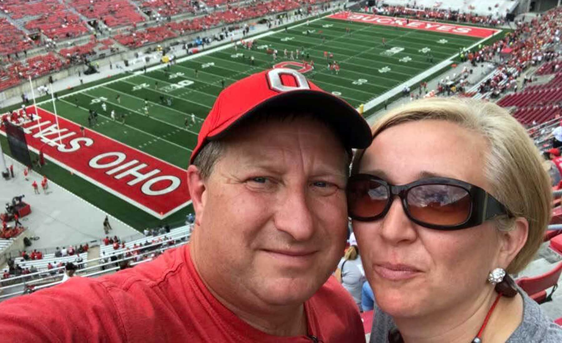 Robin Adams and her husband at an Ohio State football game