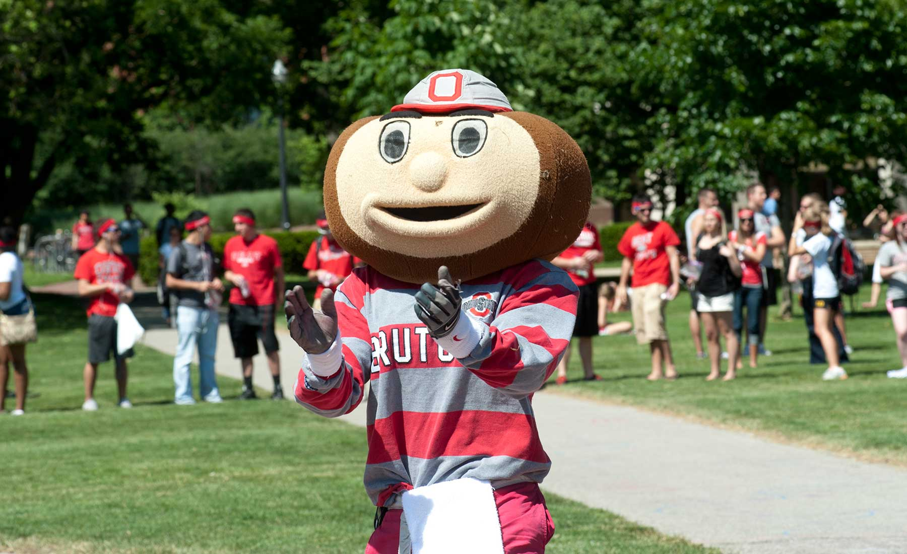 Brutus Buckeye clapping on the Oval