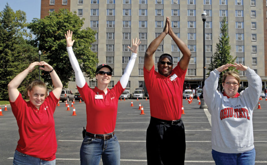 Three women and one man spelling out O-H-I-O