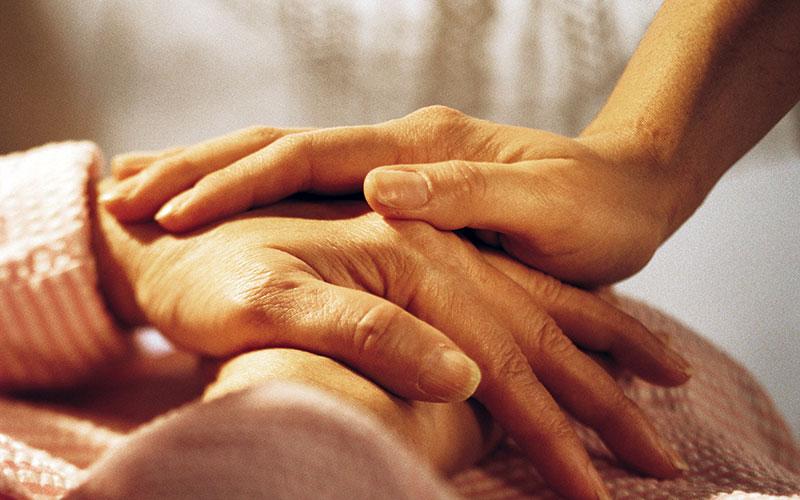 closeup of comforting hands